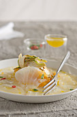 Stockfish carpaccio with artichokes, oranges and clementines