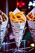 Fried squid rings in a paper bag