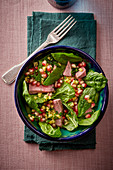Roast beef with spinach and pomegranate seeds
