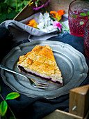 A piece of blueberry pie with goat's cream cheese for a picnic