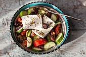 Greek salad with feta, cucumbers, tomatoes and olives