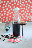Coffee liqueur in a bottle and a glass