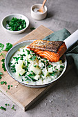 Fried salmon with kohlrabi chunks