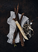 Peeled salsify on paper