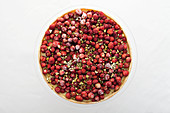 A strawberry and pistachio tart from above