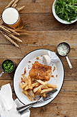 Fish and Chips served with tartar sauce, mushy peas and a pint of lager
