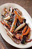 Roasted carrots in an oval dish