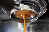 Coffee pouring from an espresso machine