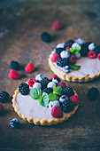 Mini tarts with custard and berries