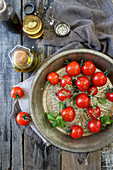 Cherry tomatoes in a metal bowl