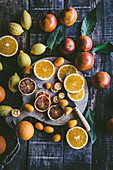 Sliced fresh different citrus fruit on wooden board