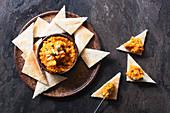 Roasted pumpkin dip spooned onto toast triangles
