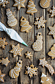 Gingerbread cookies decorated with royal icing on wooden table