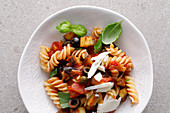 Fusilli with aubergines, tomatoes and olives