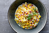 Corn chowder with bacon and cress