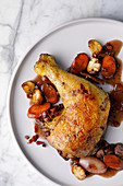 Coq au vin with carrots and mushrooms