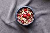 Raspberry porridge with cocoa nibs