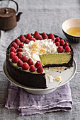 Matcha cheesecake with white chocolate and a dark biscuit collar