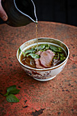 Vietnamese pho with beef and rice noodles