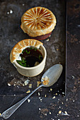 Venison consommé with truffles and a puff pastry topping