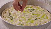 A woman making focaccia with spelt flour
