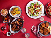 Chicken wings, fried chicken, chicken salad, corn on the cob and coleslaw