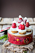 Mini Cheesecake with «Santa» Strawberry Hats on a Tin