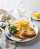 Pan-fried fish and chips with mint peas