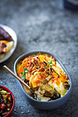 Sweet potato and butternut bake with crispy onions