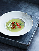 Cold celery and Granny Smith apple soup with guacamole