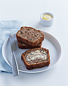 Banana and walnut bread with butter