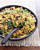 Curry rice salad with nuts and dried fruits