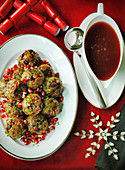 Christmas Turkey Sausage meat onion and herb stuffing with pomegranite seeds and red wine gravy