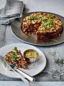 Vegetarian Christmas Macadamia and pistachio nut roast with spiced yoghurt sauce