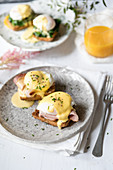 Poached eggs on toast withham and spinach and Hollandaise sauce