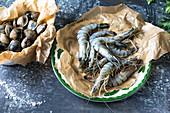 Raw prawns with clams