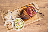 Roast duck breast with coleslaw and tortillas