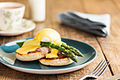 Eggs Benedict with green asparagus