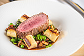 Beef fillet with beans and chanterelle mushrooms