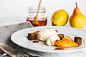 Roasted pears with vanilla ice cream and honey