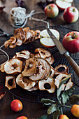 Fresh apples and dried apple rings