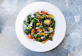 Home made spinach picci pasta served with vegetables