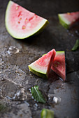 Watermelon Slices on a Metallic Background with ice and mint