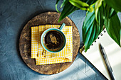 Cup of black coffee on rustic background with copy space