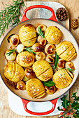 Hasselback potatoes with rosemary and onions