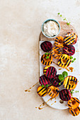 Chargrilled stone fruit with honey-and-lime syrup and tahini labneh
