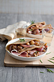 Buckwheat crepes with ham, shallots and chestnuts