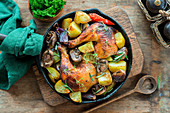 Roast hicken legs with vegetables