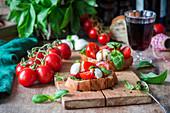 Bruschettas with mozzarella, tomatoes and pesto