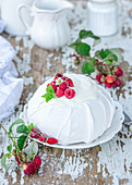 Pavlova with raspberries and sour cream